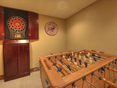 Game room with foosball, darts and board games