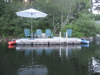 Ridgefield house photo - Dock with kayaks and a rowboat. There is also a small sandy beach.