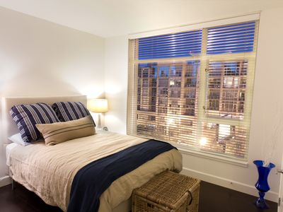 Cozy Queen Bed with City Views.