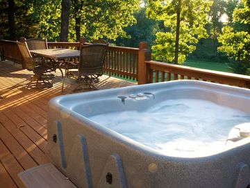 Relax in your private hot tub overlooking the valley