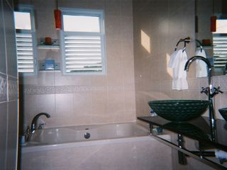 Humacao house photo - Master bathroom with jacuzzi and shower.