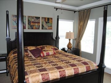 Master bedroom. French doors lead to back patio.