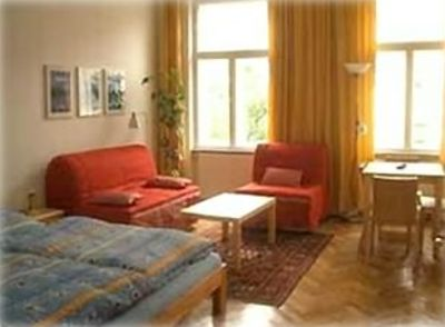 Living Room with double bed and 2 sofa-beds, eating place, TV and internet!