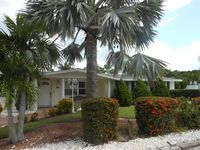 Charming beach house with pool/canal front/dock/private beach access/pet o.k.