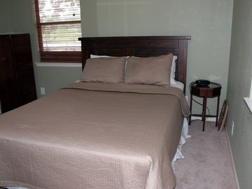 One of recently renovated bedrooms with new mattress, linens, & LCD TV+DVD.