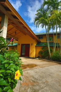 The house has a Hawaiian tropical feel, and flowers and trees create privacy.