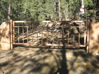 Santa Fe cabin photo - The front gate to the community at State Rd 63
