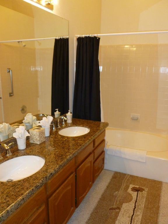 Master Bath with new granite double sinks and oversized tub.