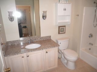 Manistee condo photo - Bathroom with tub and shower