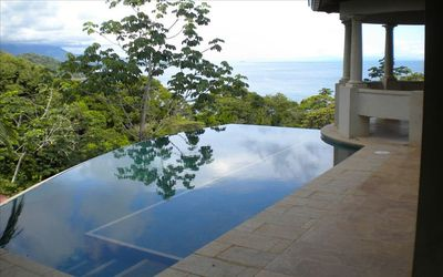 Infinity edge pool with lounging platform. What a great way to lay in the sun!