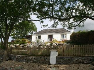 County Mayo cottage photo - Carrowholly Cottage from the Road with drystone wall and fencing.