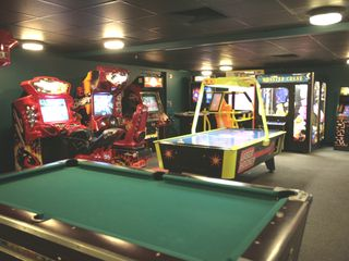 Huge arcade game room on lower level of the Ocean Walk. - Daytona Beach condo vacation rental photo