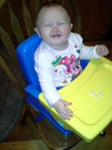 Grandbaby Kaylynne in one of the baby items at the cabin--Pack 'n' Play too