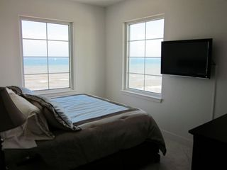 Master bedroom with king size bed and a beautiful view from your bed down the en
