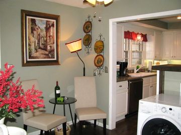 Wine room/laundry room, looking into kitchen, gas stove, all stainless steel