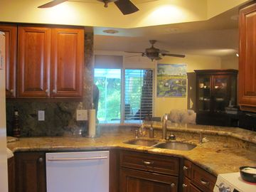 Kitchen has top of the line appliances and granite