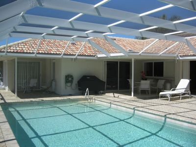 Enjoy the large south facing pool and 1700 Sq. Ft. Screened Lanai