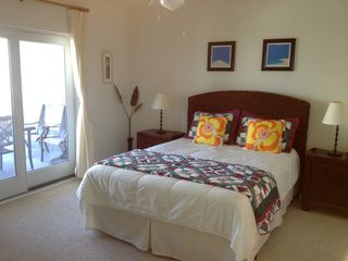 Wildwood Crest condo photo - master bedroom with sling door to balcony and a 42' LCD TV