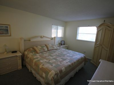 Master bedroom is equipped with a king bed and private bathroom.