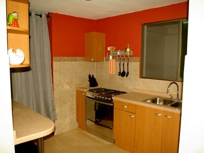 Fully equipped kitchen with new high end appliances, cookware, and dishes.