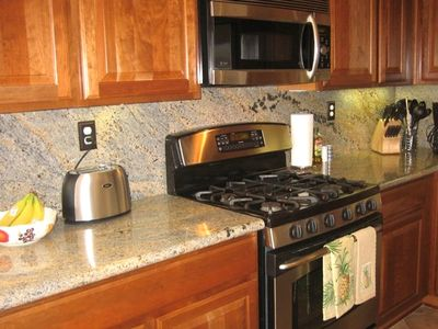 Kitchen with granite countertops & stainless steel appliances