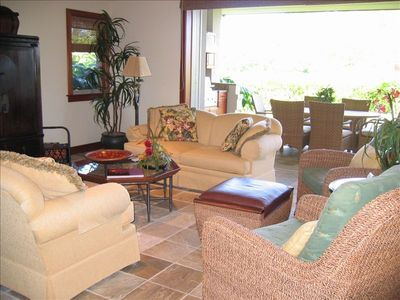 Living Room toward back lanai and a lovely garden view