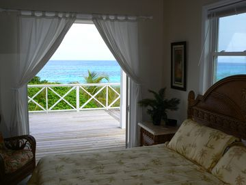 The master bedroom features a king bed, French doors & a gorgeous ocean view!