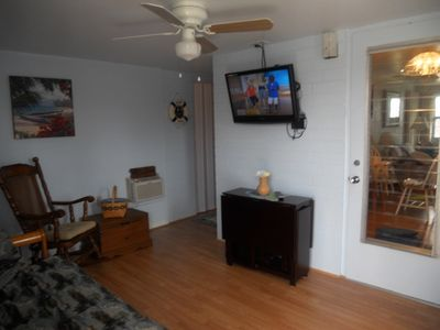 New renovated Fl. rm.w/access to back porch and brand new top/bottom wash/dryer!