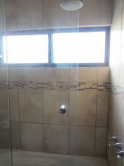 Tamarindo condo photo - rain forest shower and jacuzzi, master bath