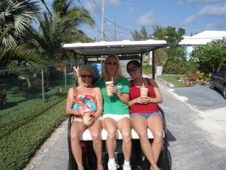 Golf cart cruising on the optional golf cart rental. - Spanish Wells villa vacation rental photo