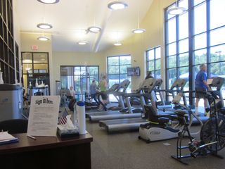 Galena house photo - Fitness room with great equipment and tons of windows to enjoy the view