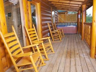 Pigeon Forge cabin photo - Deck with rockers, private jacuzzi - view to left