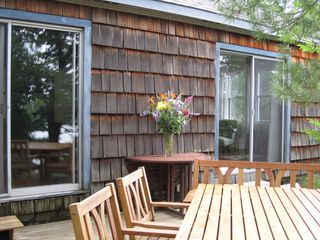 Stoney Lake cottage photo - Dining deck of Main Building, near sitting area left, Master Bed Rm right, DR&LR