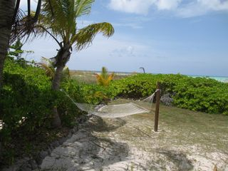 Relax in the hammock and read a book or take a nap. You're on vacation! - Spanish Wells villa vacation rental photo
