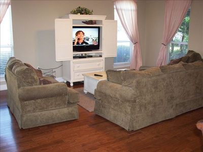 Big living room with hardwood floors, flat screen TV and plenty of room!