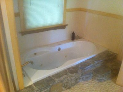 Enjoy the sunken jetted tub in the first floor bath. Soak away your worries!
