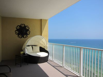 Lounge with a drink in soothing seclusion on your gulf front 28 foot balcony