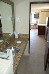 Cancun condo photo - Bath w/ Brazilian marble shower & granite counter
