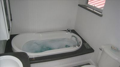 Comfy soaking tub, separate shower.  Outdoor shower with hot and cold water too!