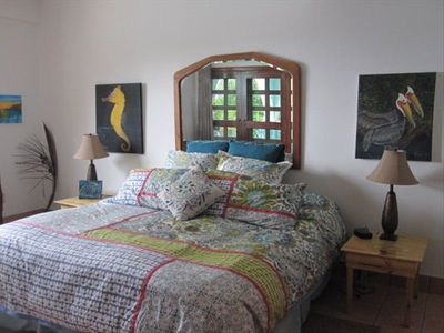 Ambergris Caye condo rental - Master bedroom w/ocean view & patio doors to the Lanai