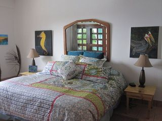Ambergris Caye condo photo - Master bedroom w/ocean view & patio doors to the Lanai