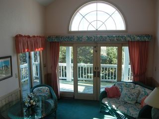 Corolla house photo - Quiet Sunroom with Estuarine Sanctuary visible through wall-to-wall glass doors