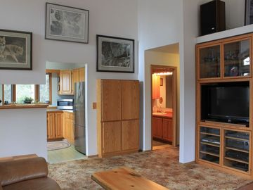 Soldotna house rental - Livingroom with cathedral ceilings and local Alaskan artwork