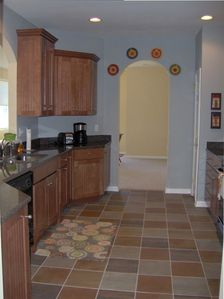 Deluxe kitchen with granite countertops and beautiful cabinents