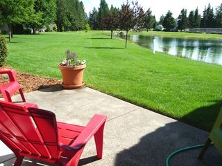 Twin Lakes condo photo - Patio off the living room overlooking the pond and 15th hole of the golf course.