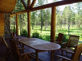 Whitefish cabin photo - Teak table on front deck, relax in seclusion