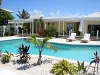 Direct Oceanfront Charming Cottage inside Luxury Estate with heated pool
