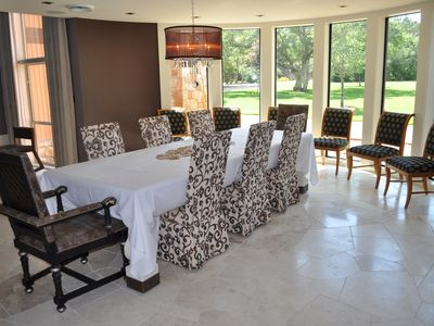 The dining room with a massive table that can fit up to 15 dinner guests.