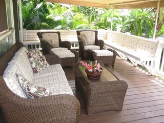 Sunset Beach house photo - Relaxing covered lanai area with fenced in yard and playgym
