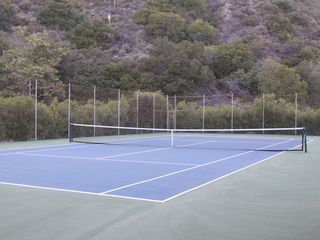 Malibu house photo - Two tennis court, private to the Malibu West community, are available for guests